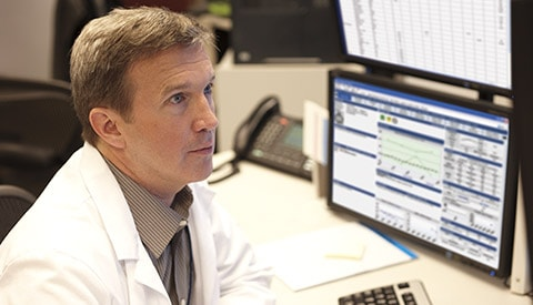A doctor analyzing telehealth data